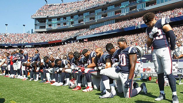 Several Patriots players took a knee during the National Anthem Sunday before the Houston Game.  Tom Brady stood with Matthew Slater and others with their arms interlocked.  It was reported that the boo's were loud coming from the fans.