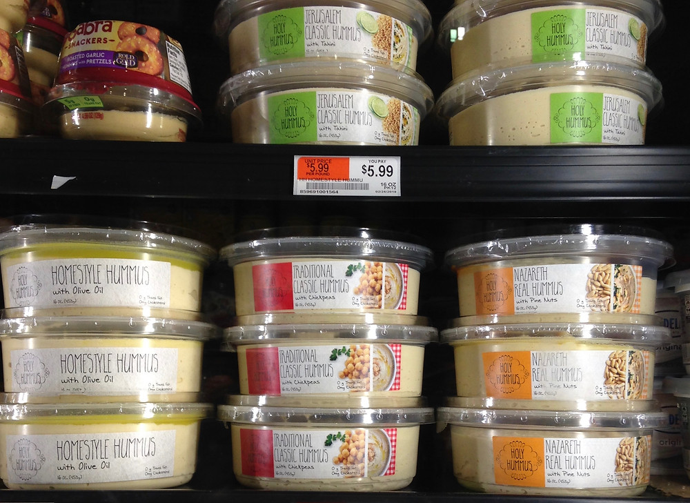 display case of the four different styles of Holy Hummus