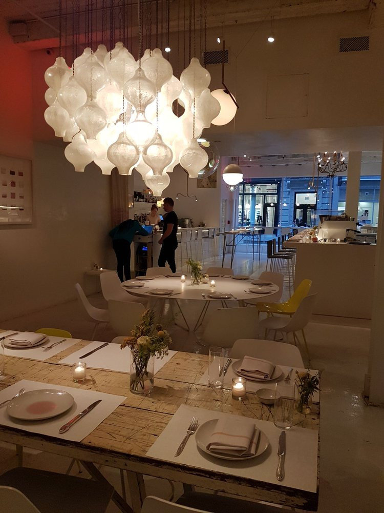cluster of individual white lights form an centerpiece chandelier