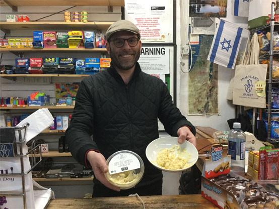 Eran Hileli demonstrating how to create the ultimate hummus adventure.