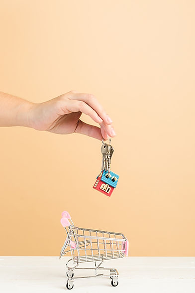A set of key being placed in a shopping trolly. This represents DJB Mortgage searching for the best mortgage deal by going out to the mortgage market shopping around for the best deal for the clients needs.