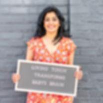 Khyati Desai-Seltzer owne and founder of Vyana Infant Massage, holding sign