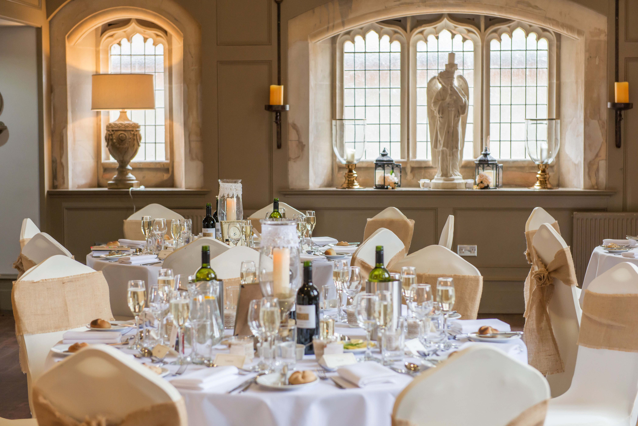 Photography of wedding breakfast room decoration and layout in Ellingham Hall wedding venue in Northumberland