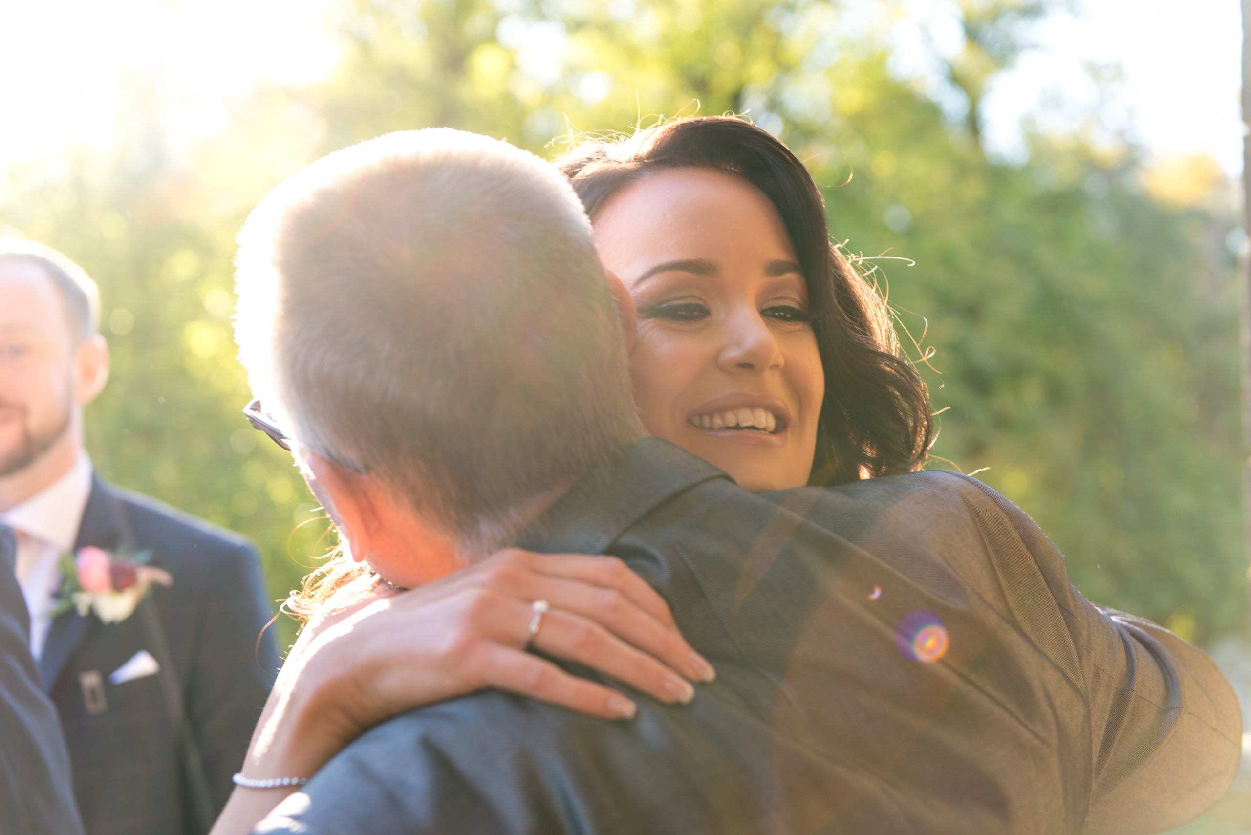 Photo of wedding day guest giving congratulations to bride after wedding day ceremony