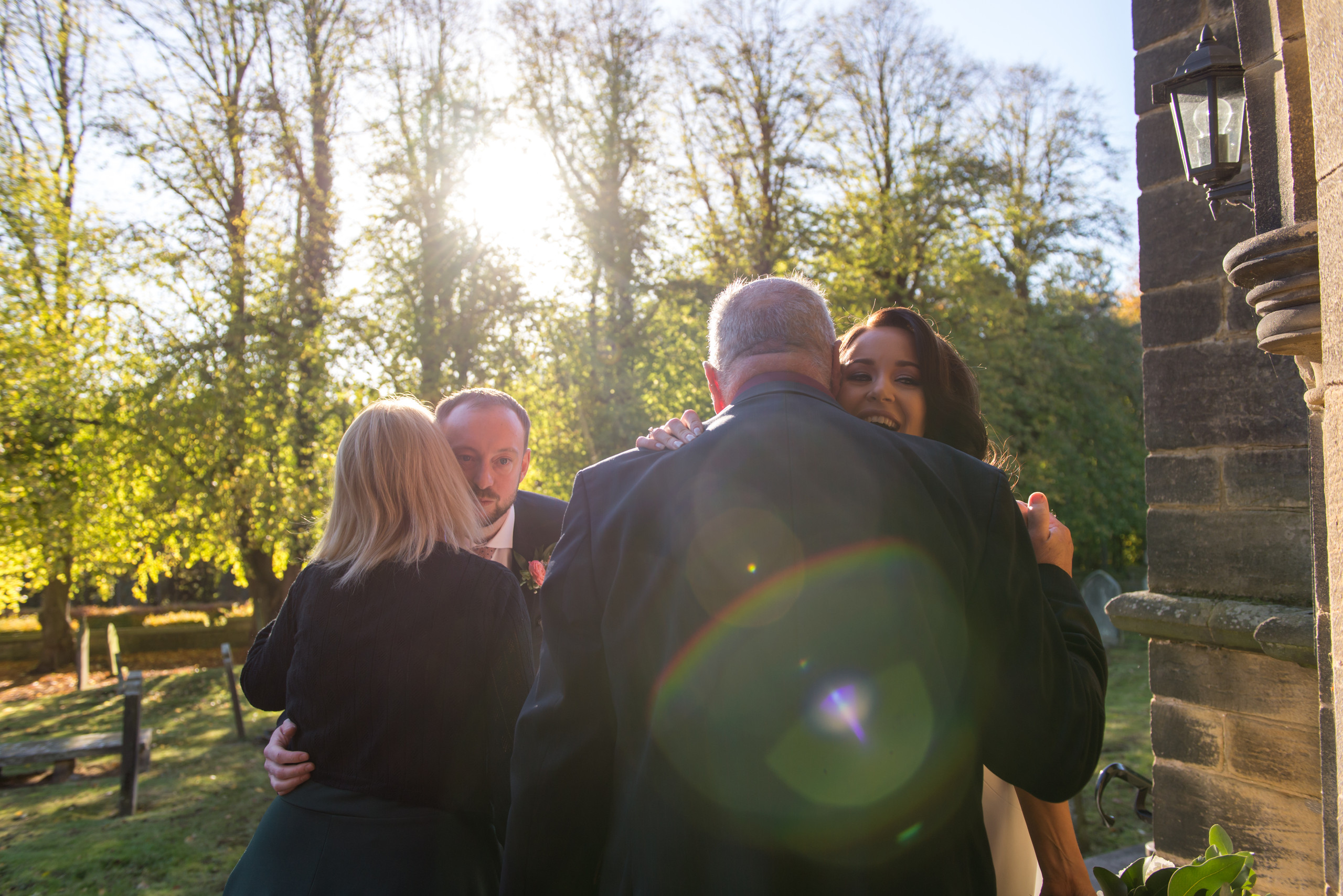 Bride and groom celebrate wedding ceremony with guests outside of church