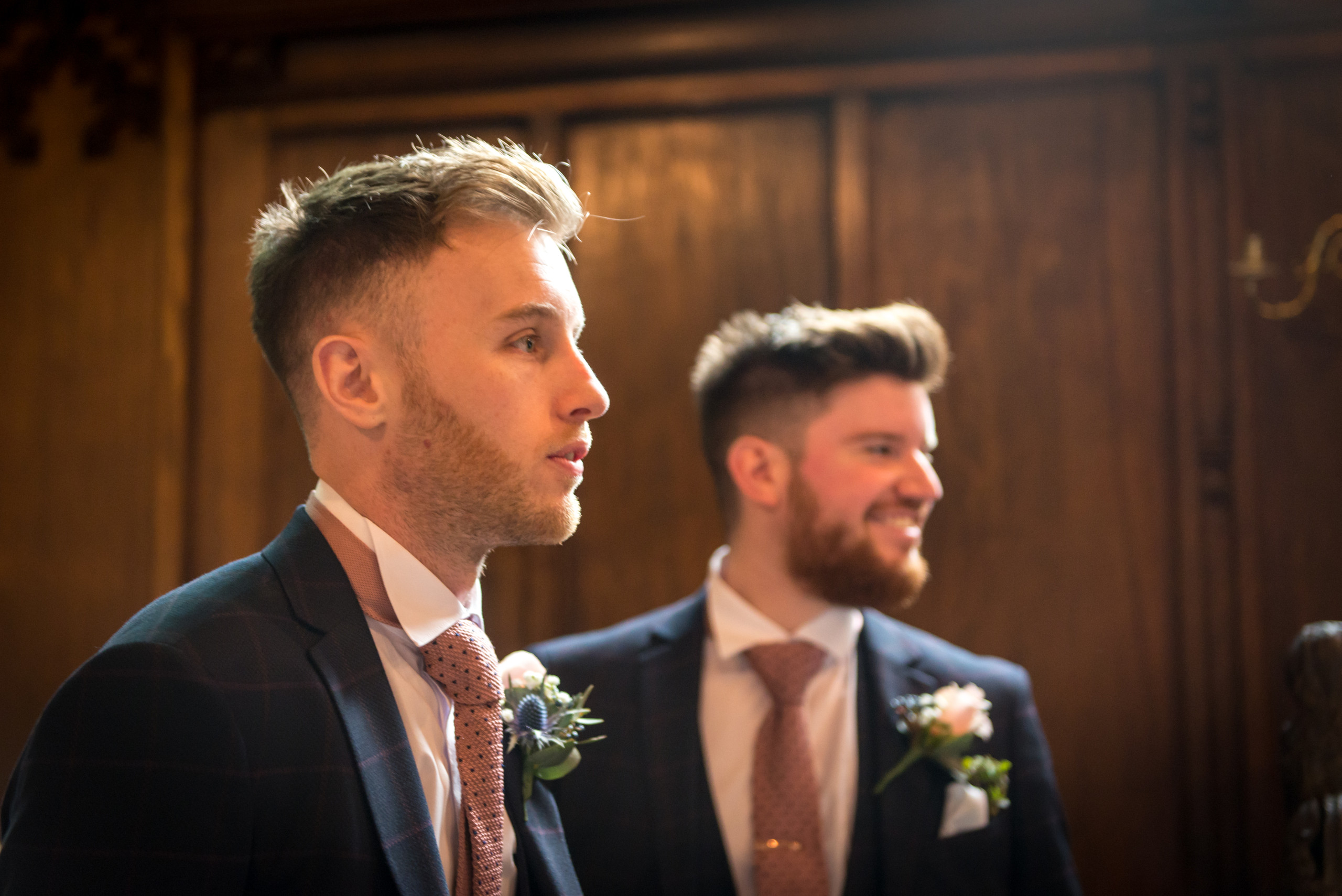 Photograph of nervous groom awaiting the bride in historic Tunstall Chapel of Durham Castle on day of wedding ceremony