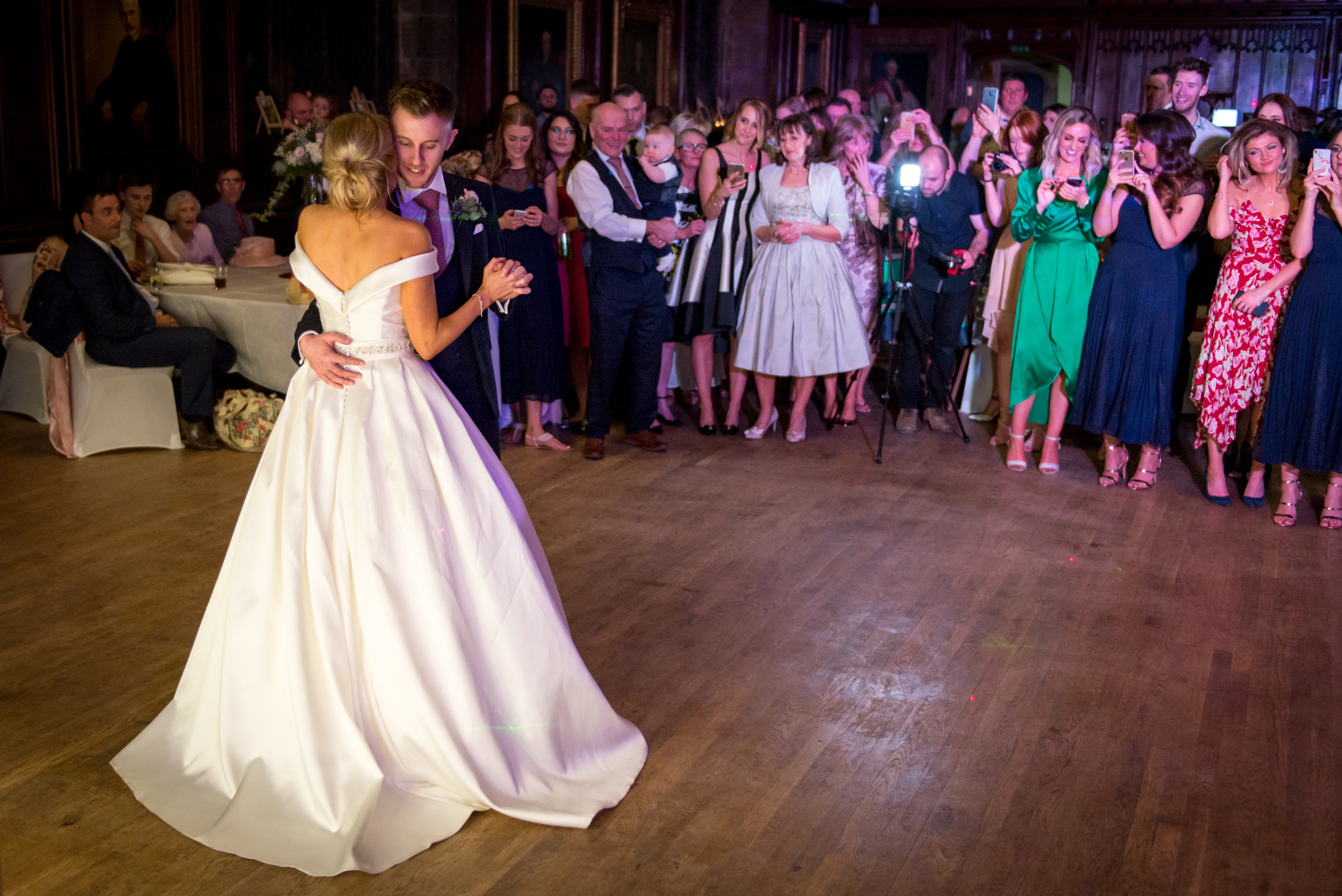 Photograph of bride and groom's first dance in Bishops Hall during wedding evening celebrations at historic venue Durham Castle in Durham City