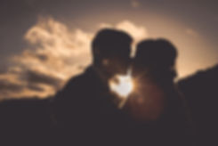 Bride and Groom kiss during evening Suns