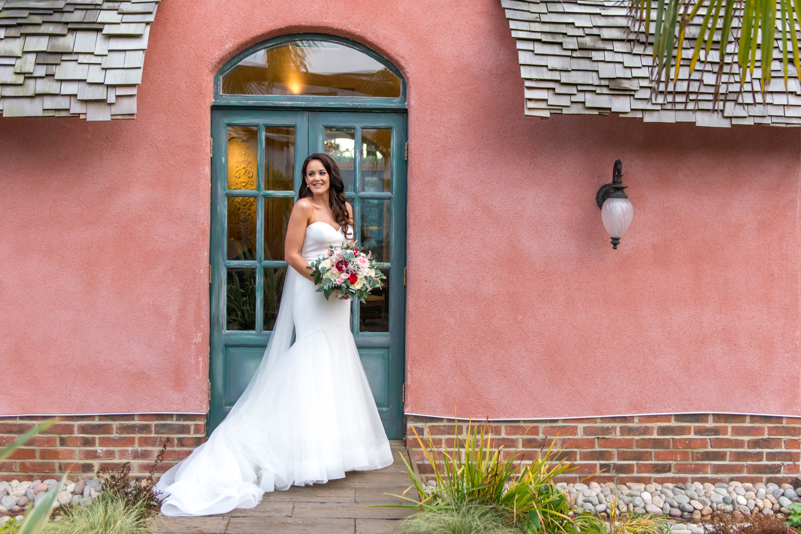 Relaxed photograph of bride smiling on wedding day at Le Petit Chateau in Otterburn, Northumberland, by Bride and Groom Wedding Photography