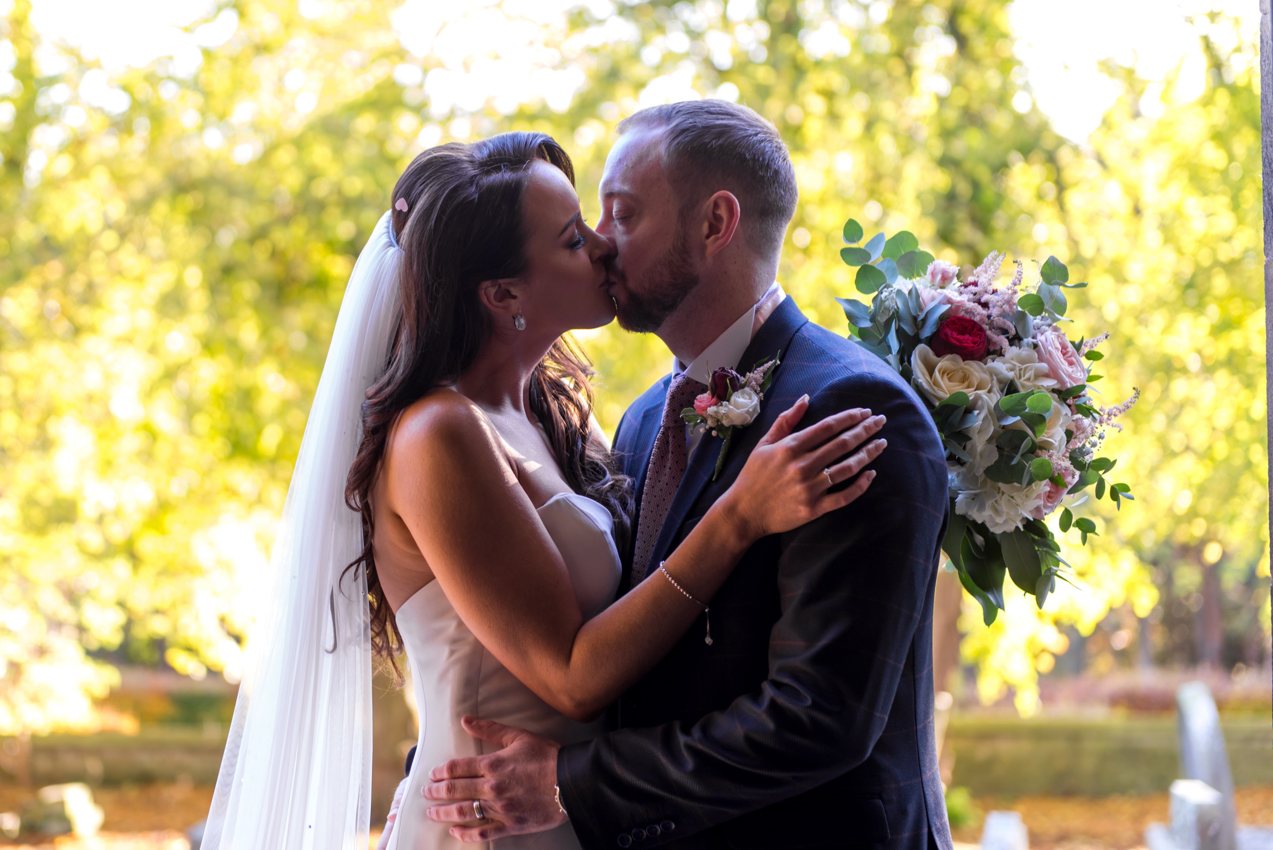 Photograph of bride and groom kissing on wedding day by Bride and Groom Wedding Photography