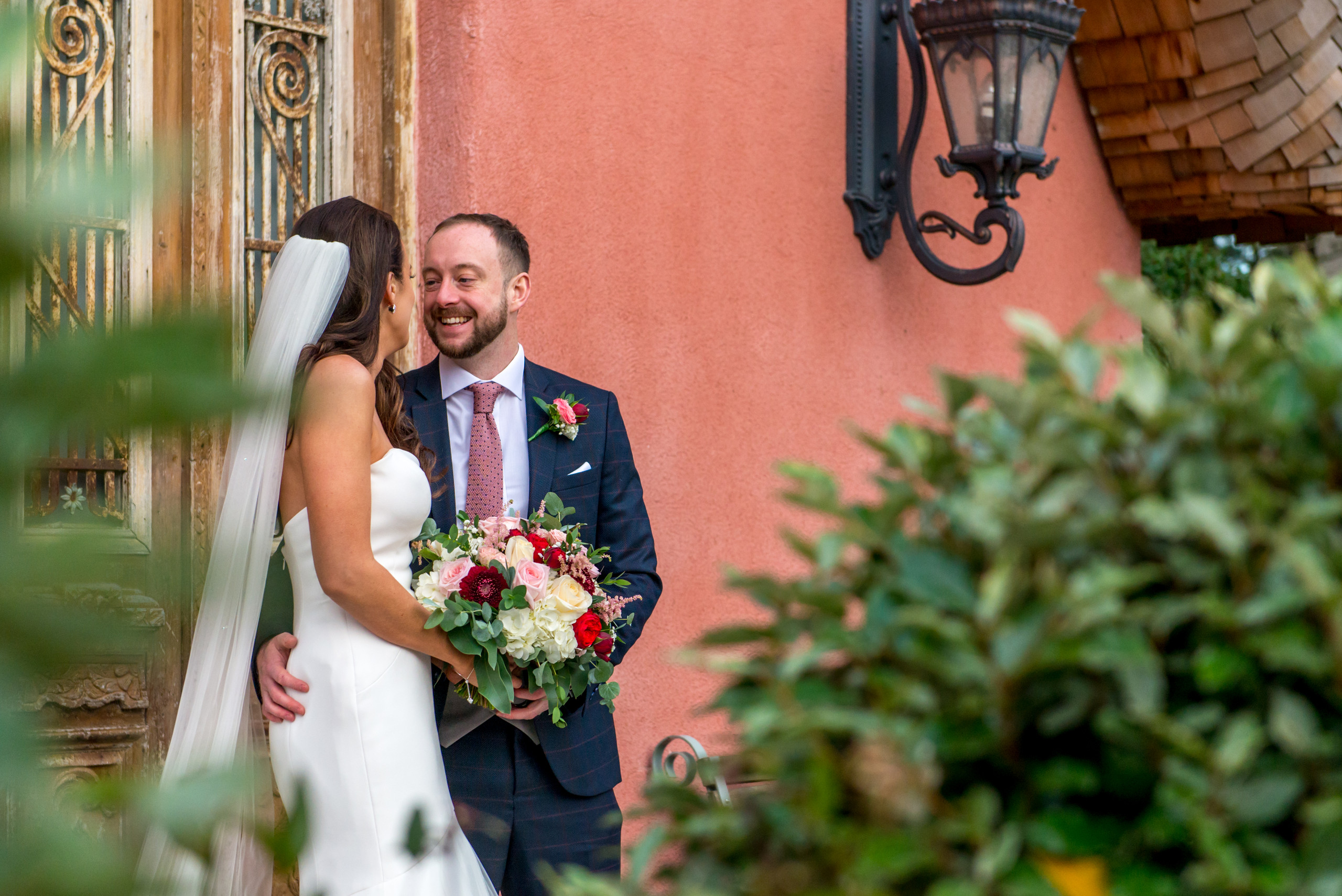 Candid, rRelaxed photograph of groom smiling at bride on wedding day at Le Petit Chateau in Otterburn, Northumberland