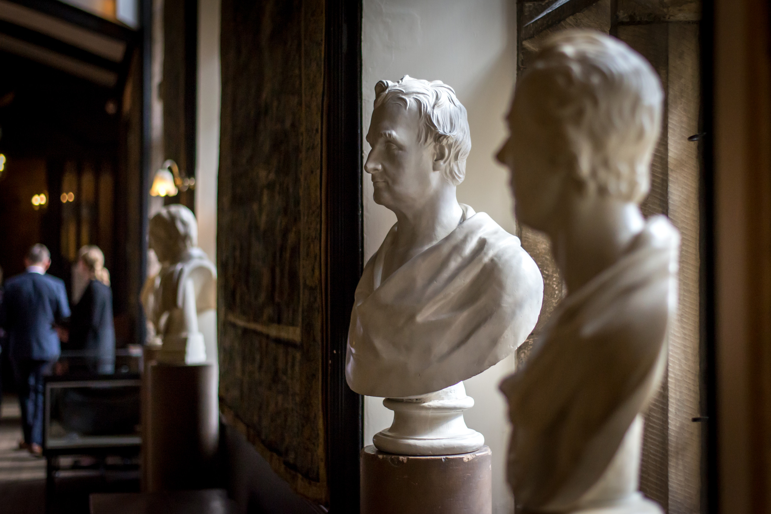 Marble art sculpture or alabaster busts in corridor of historic Durham Castle in England