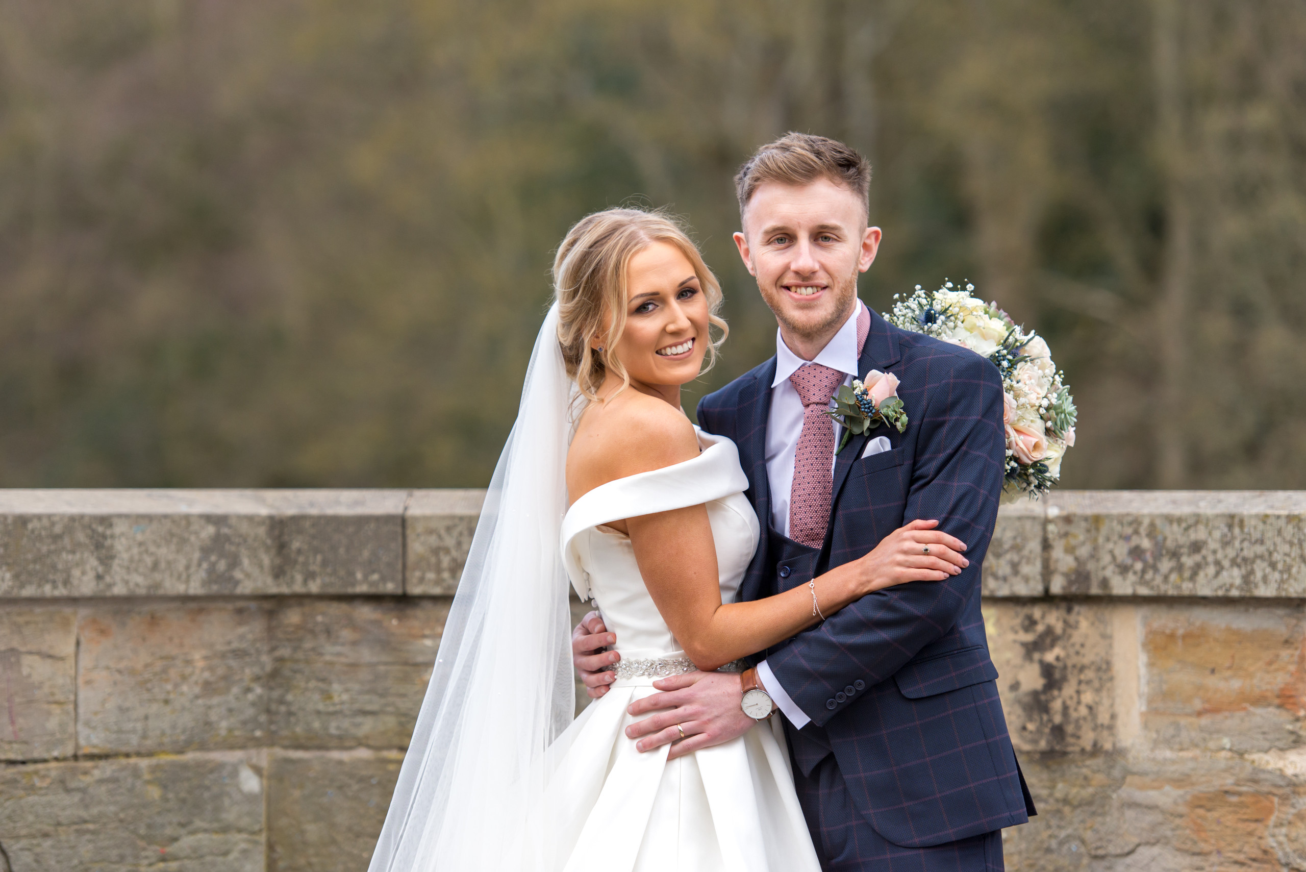 Relaxed wedding photography of bride and groom on wedding day on Prebends Bridge in Durham