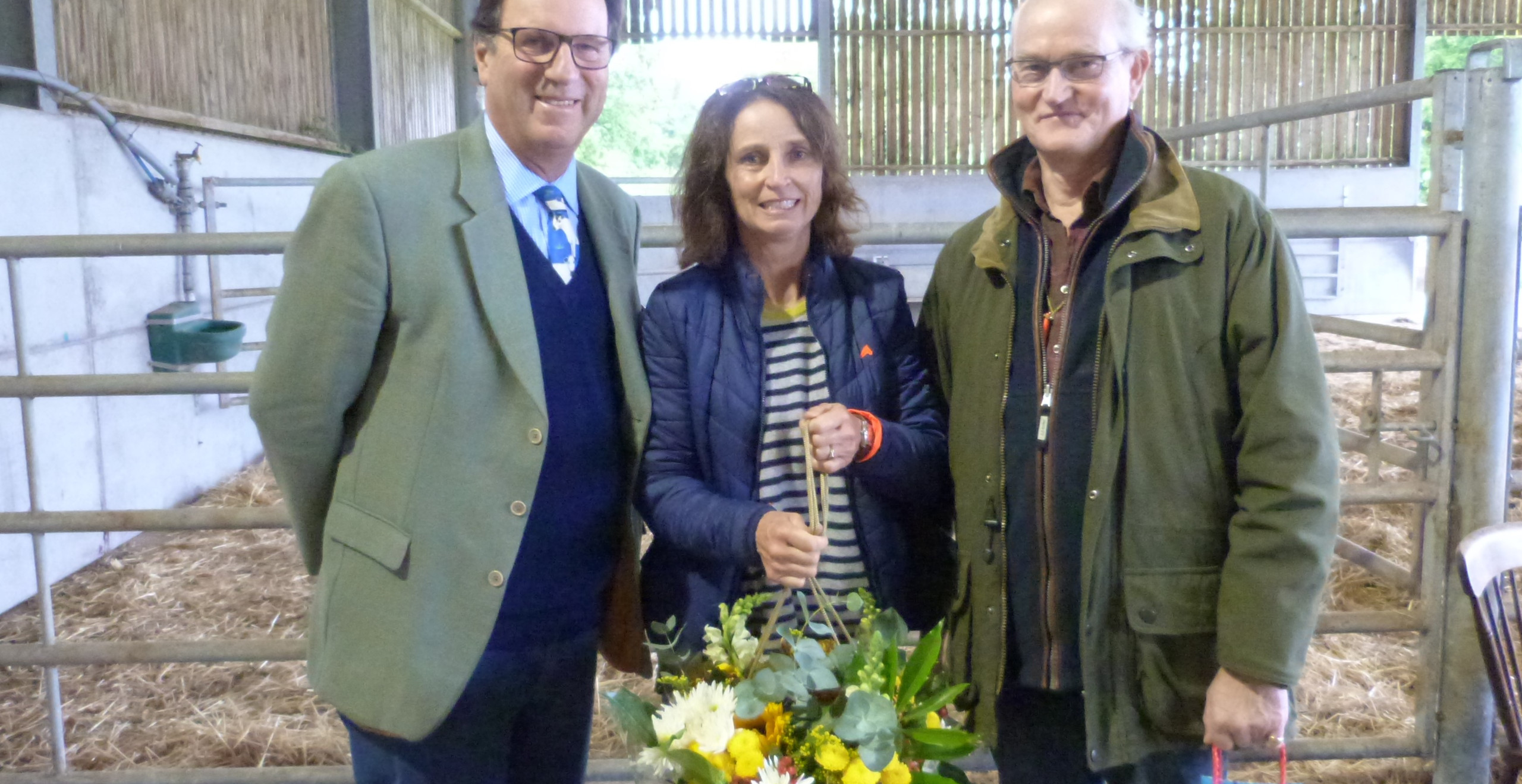 Henry Cator presents a token of thanks to hosts David and Stephie Trafford