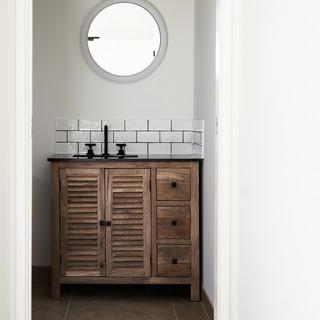 timber vanity with round mirror.jpg