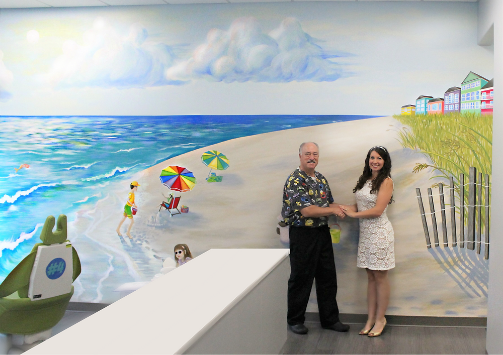 Artist Angela Kelly with Dr. Fry in front of Mural