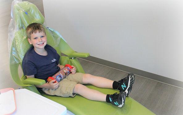 Child receiving dental treatent.