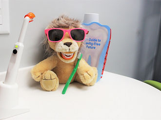 Lion plush wih teeth.