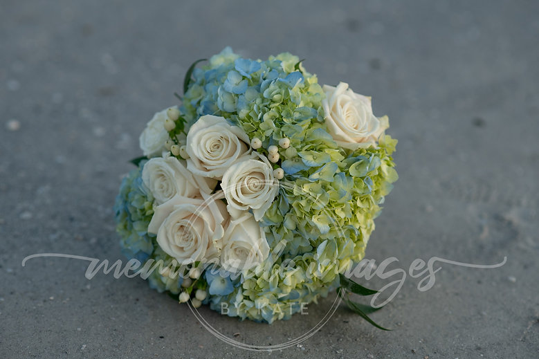 White roses and blue hydrangeas bridal bouqet