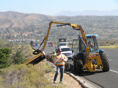 construction worker on freeway next to crane