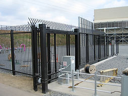 black fencing with steel guide rail