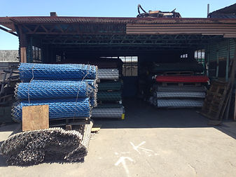 fence construction yard with materials bundled up and stacked