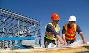 construction workers looking over blueprint together