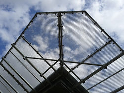 chain link roofing in front of cloudy sky