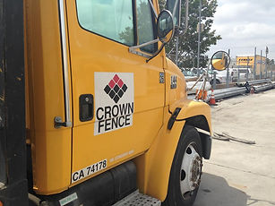 yellow truck with crown fence logo