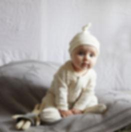 Baby girl wearing Toffee Moon Star Babygrow