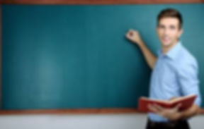 27055149-young-teacher-near-chalkboard-i