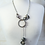 Thumbnail: Silver & Rubber Wave Lariat Necklace