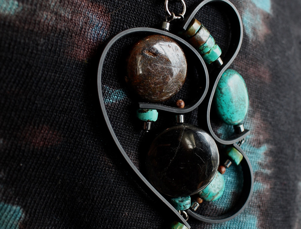 Hyperstene and Turquoise with black rubber accents
