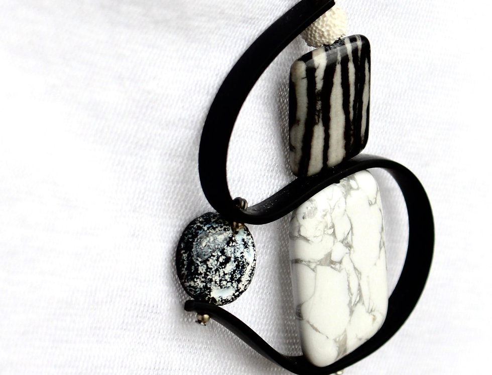 Picasso Jasper, Howlite Surrounded by Black Rubber