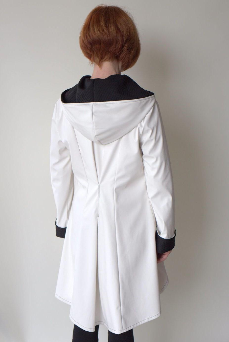 white raincoat back view