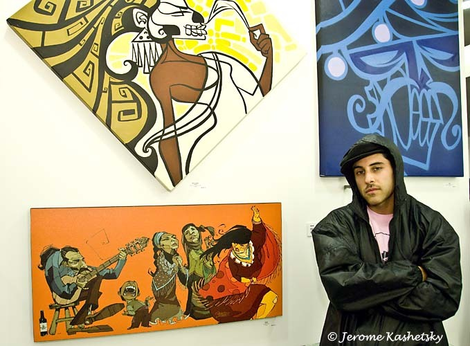 Dedos in front of his works