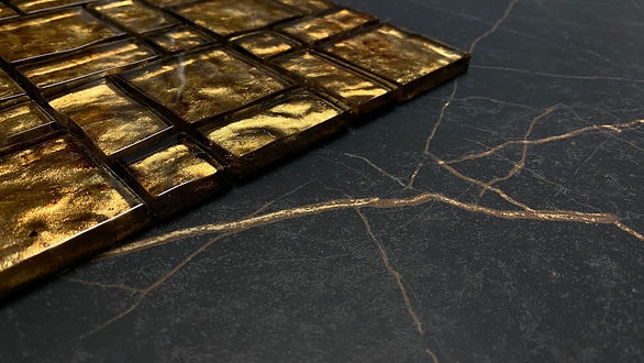 Black tile with gold veins and gold mosa