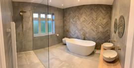 Grey Herringbone Tile Bathroom