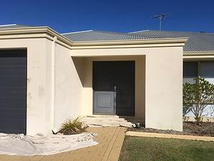Before external render and front door paint