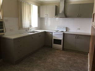 Renovated Kitchen with new cabinets, benchtop and splash back