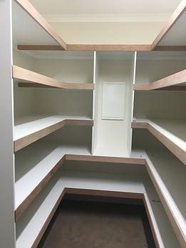Shelves for storage in walk in robe