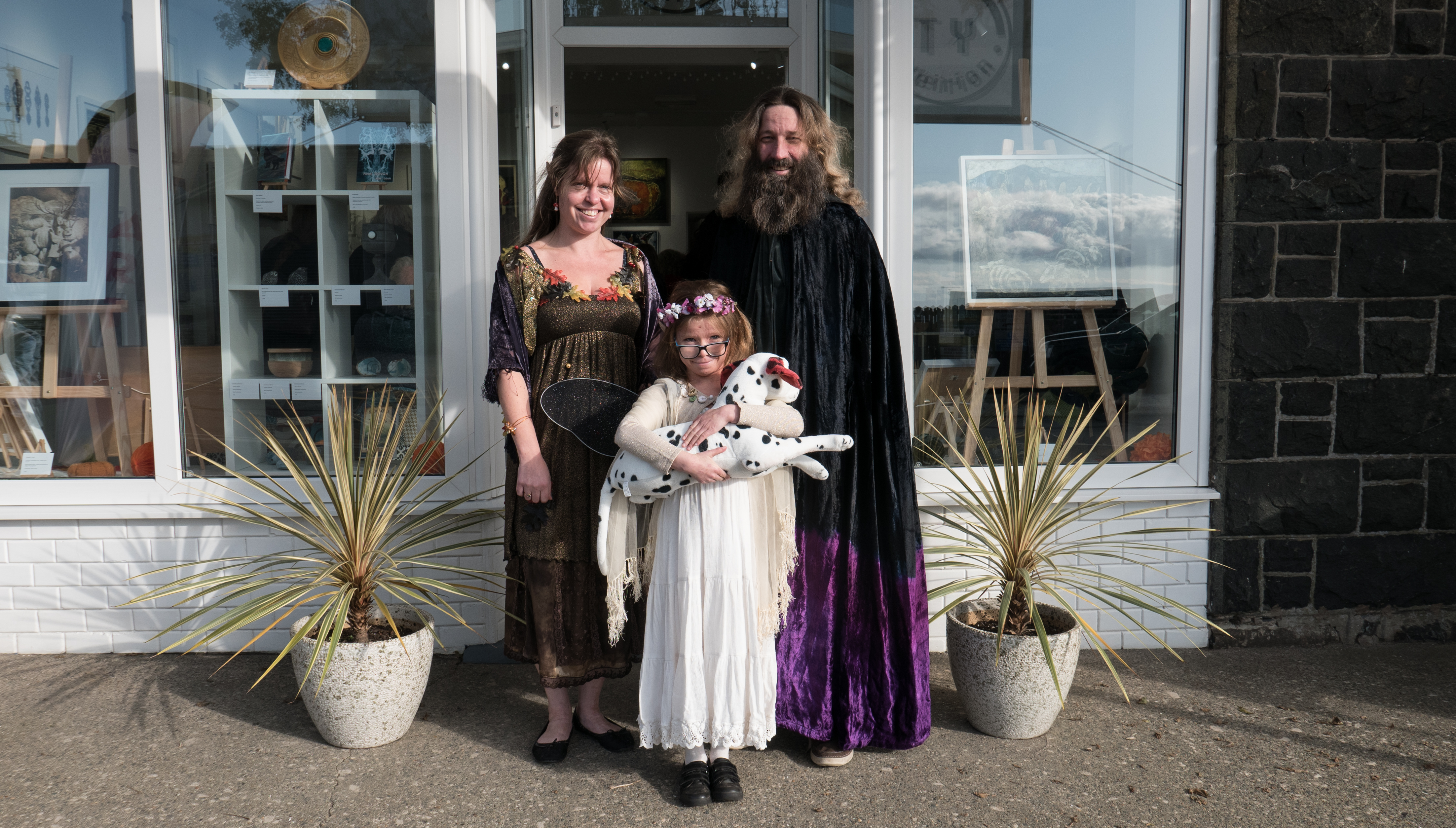 Katy Jones - Illustration artist with husband and daughter at the launch dressed in theme