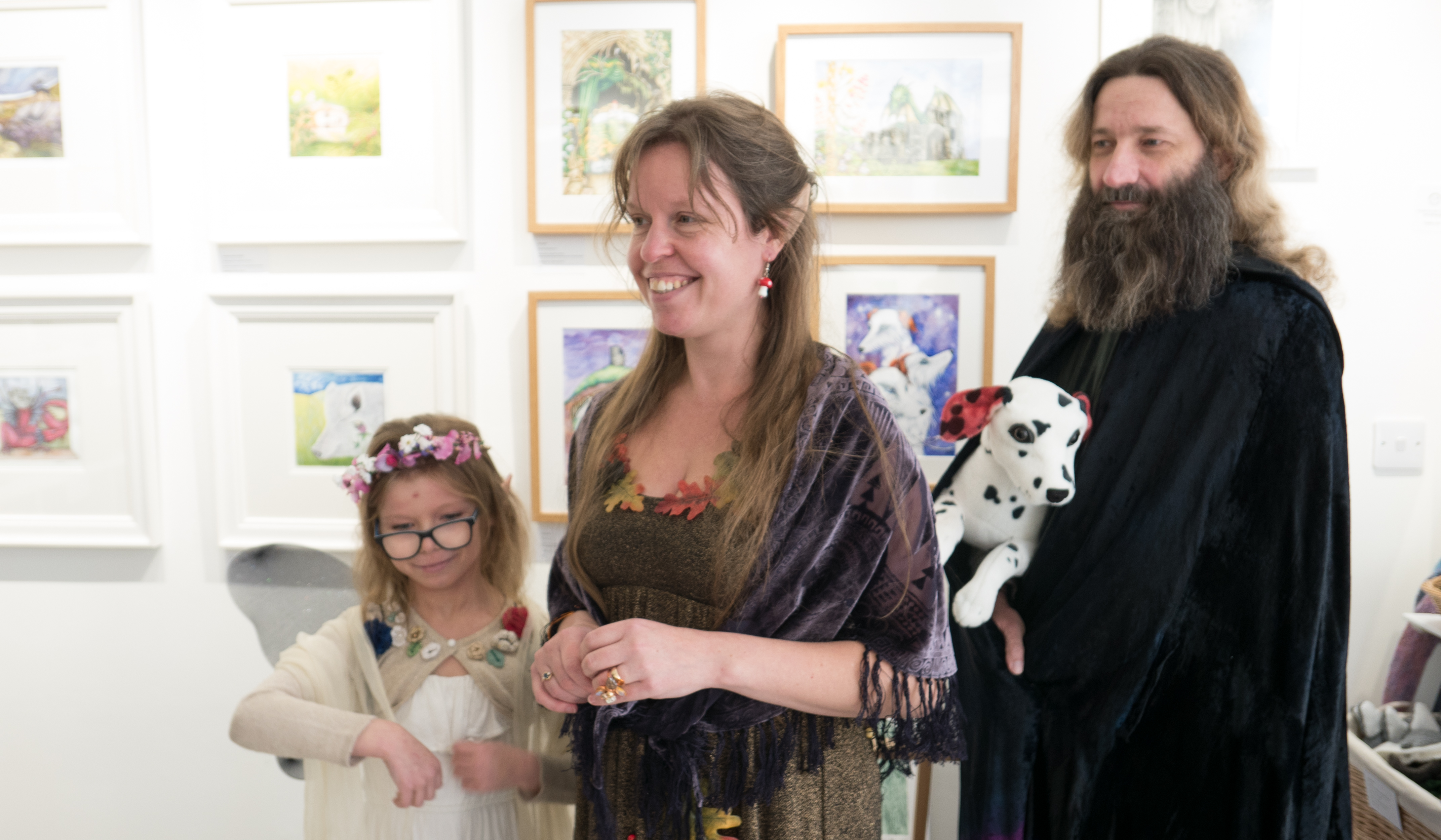 Katy Jones with family at the launch with her works behind.