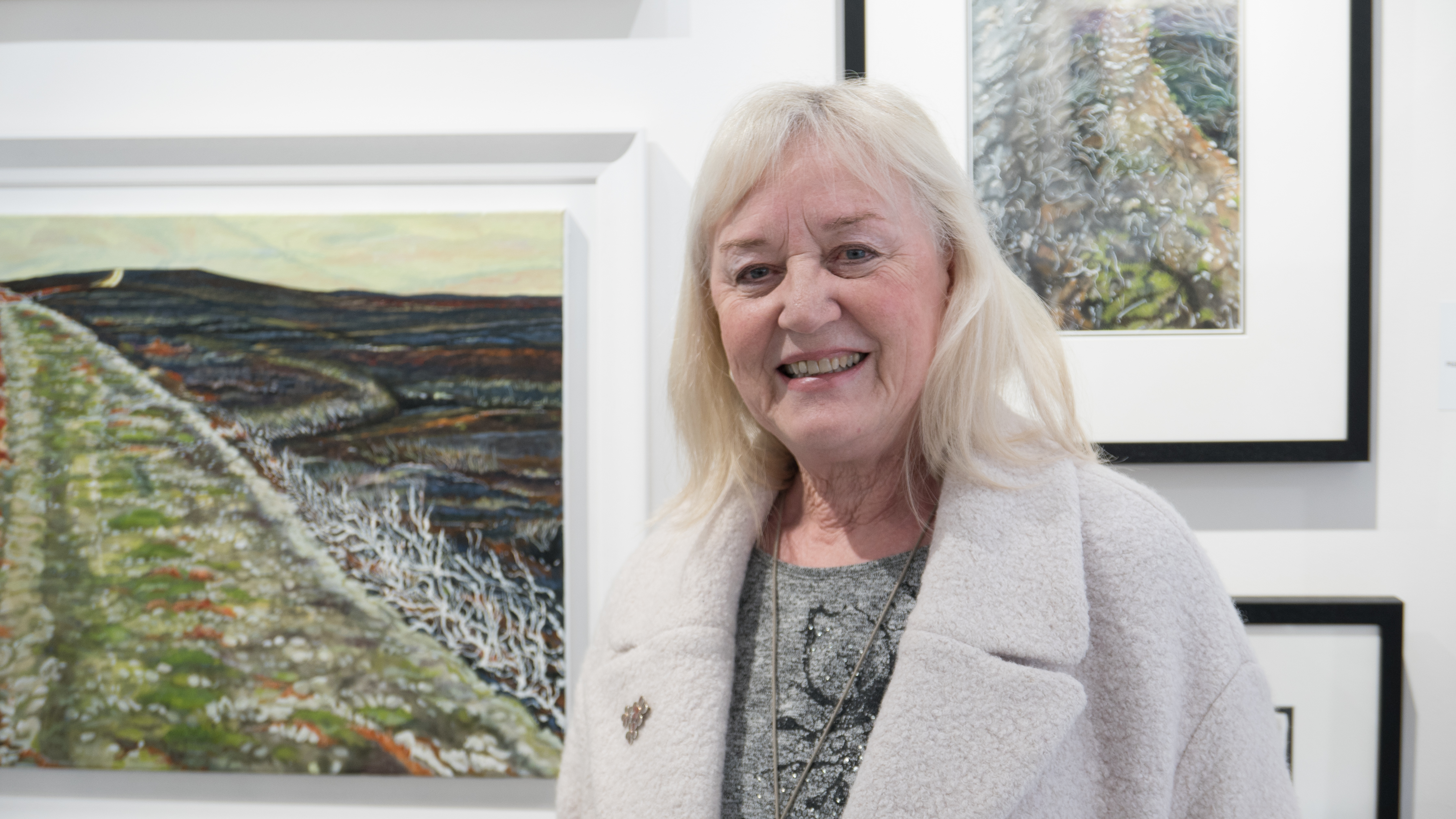 Dorothy Taylor with her works