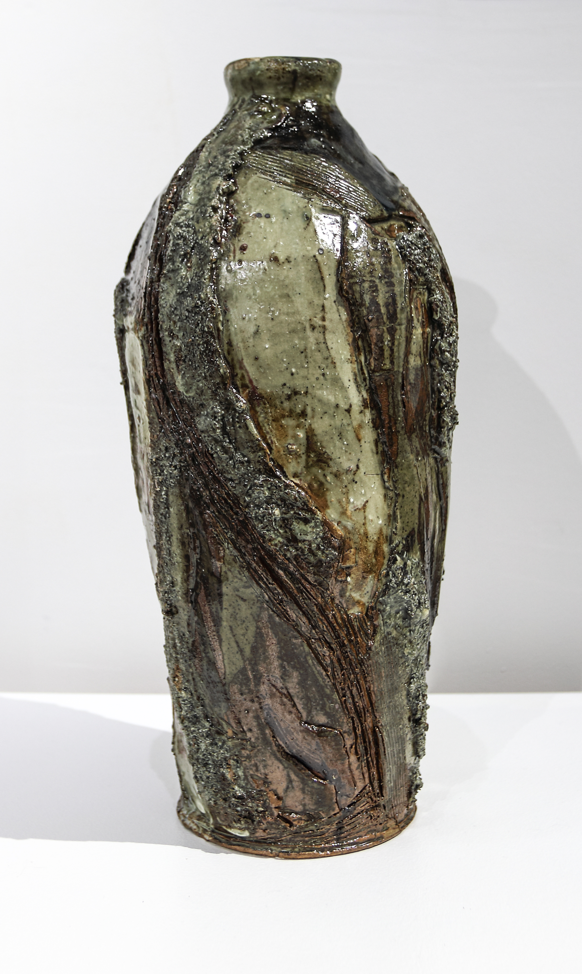 Terrence Bunce, 'Chwarel' Thrown, carved and altered bottle. SOLD