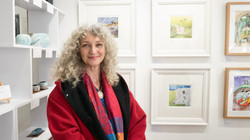 Katherine Sutar Caddick in front of her works at the launch