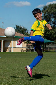 Boy playing soccer at Brazilian Soccer Training Center