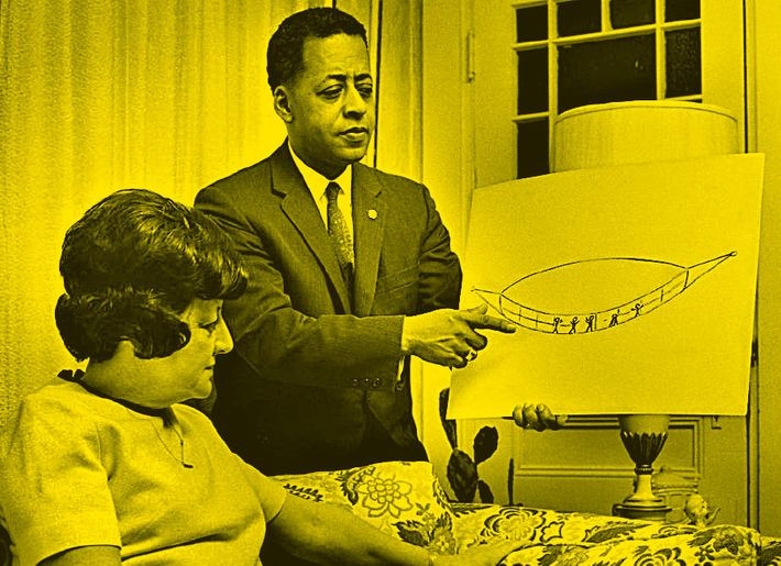 Betty and Barney Hill showing a drawing of the space craft and the Grey's