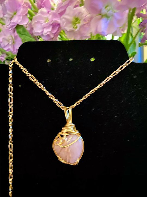 Heart shaped Rose Quartz wrapped in copper