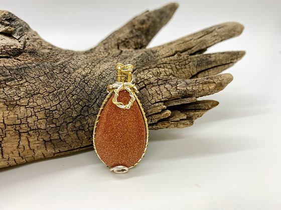 Gold stone wrapped in Copper and silver